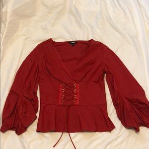 red long sleeve belted shirt